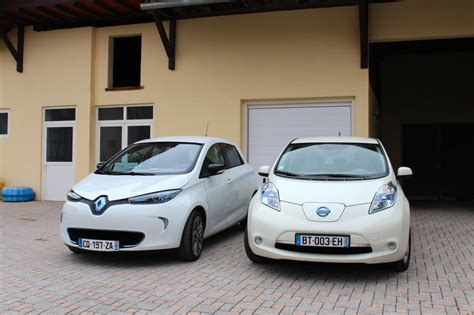 Renault Zoe And Nissan Leaf Side To Side, In Front Of The