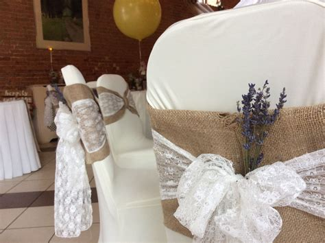 rustic hessian chair covers with a delicate lace sash and