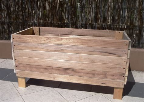 large reusable and reclaimed raised wood planter boxes