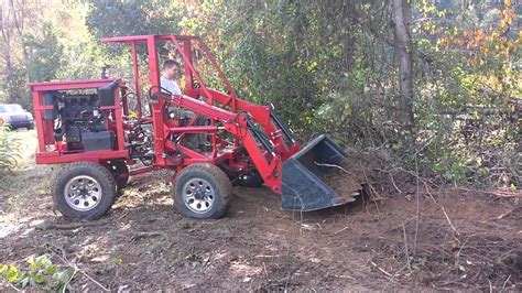 homemade tractor articulating tractor front end loader clearing brush