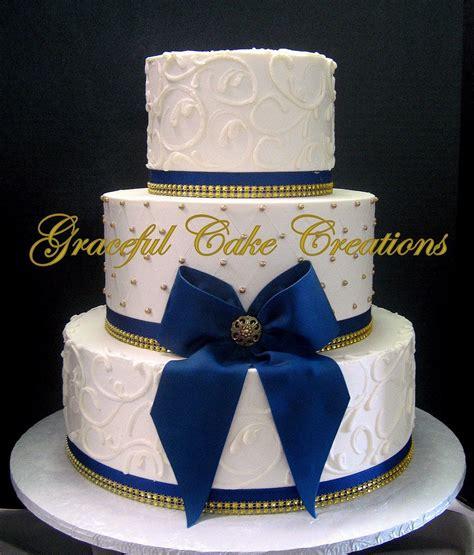 elegant ivory butter cream wedding cake  gold sugar