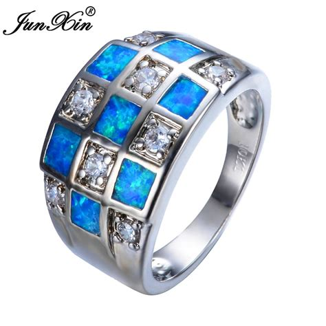junxin unique geometric design blue fire opal ring luxury cubic zirconia wedding rings for women