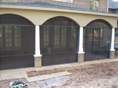covered porch columns  homes charlotte nc tapered columns  eyebrow arch stucco arches