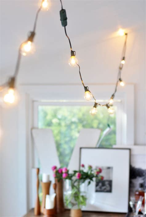 decorating with hanging globe lights indoors glitter