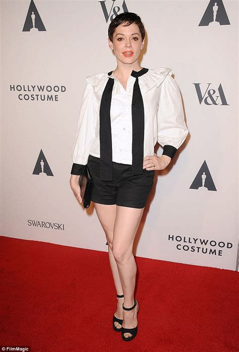 Rose McGowan in red as she color-coordinates with her new ...