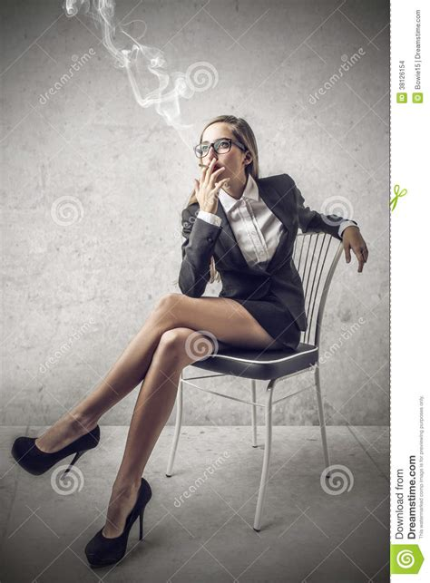 business woman smoking  cigarette stock images image