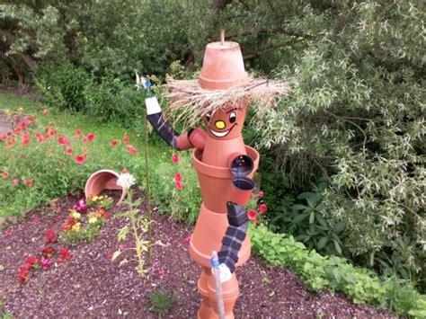 bonhomme en pot de fleur parterre de fleurs 4 photos guigui03