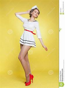 Beautiful Pin-up Girl Dressed A Sailor Posing On Yellow ...