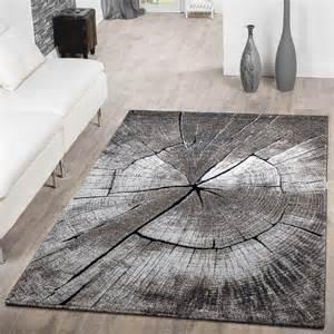 teppich designer teppich modern edel mit konturenschnitt baumstamm natur design grau braun beige moderne teppiche