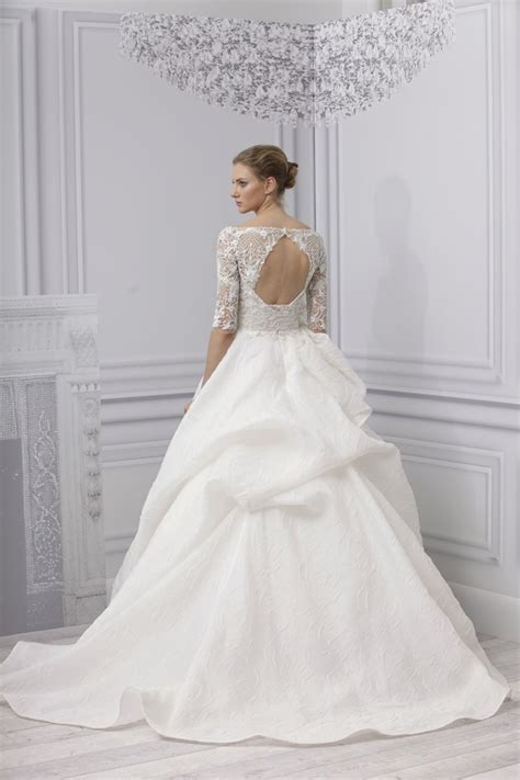 the wedding dress with a dramatic back arabia weddings