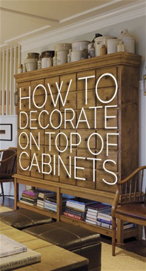 Decorating Ideas For Tops Of Kitchen Cupboards by How To Decorate The Top Of A Cabinet And How Not To