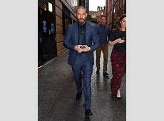 Tom Hardy in welltailored suit with Noomi Rapace at the