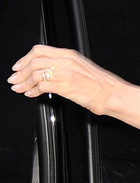 angelina jolie flashes wedding ring during day out with