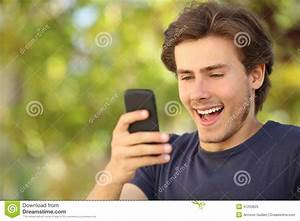 Happy Man Surprised Looking At The Smart Phone Stock Photo ...