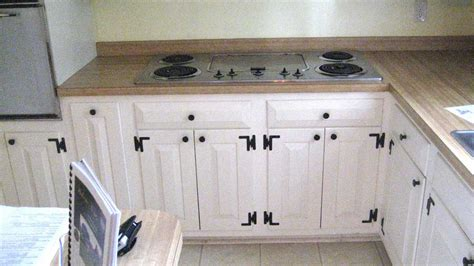 white cabinets  dark cabinet hardware  cabinet hinges giorgi kitchens designs