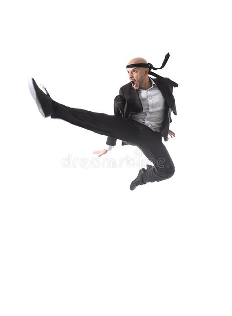 funny aggressive businessman wearing suit jumping