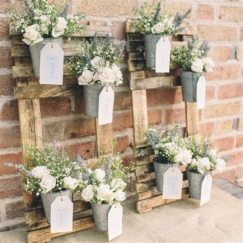 Rustic Wedding Table Plan with Flower Pots The Wedding