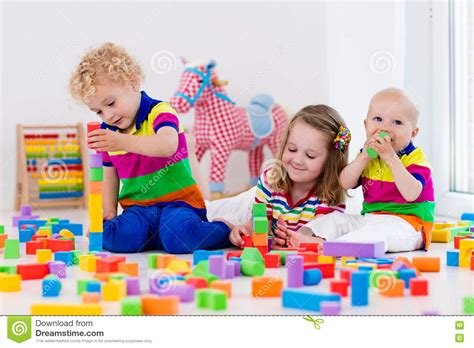 with colorful blocks stock photo image 560 | kids playing colorful toy blocks happy preschool age children play plastic creative kindergarten build block tower 74885930