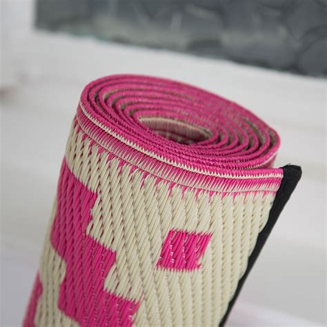 pixel outdoor rug  pink white geometric patterned