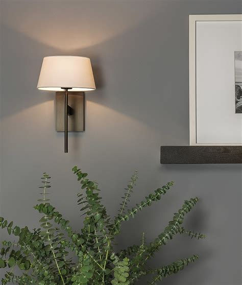 elegant wall light with fabric shade is available in three