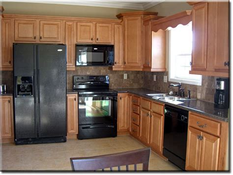 oak kitchen cabinets with black appliances smart home kitchen