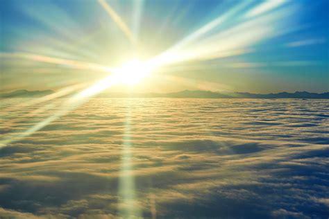 fototapete sonnenaufgang ueber den wolken jetzt bestellen