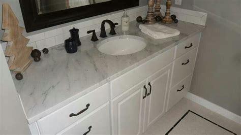 marble top  vanity  white subway tile