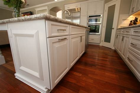 what of paint on kitchen cabinets painted white traditional kitchen with large island in 2146