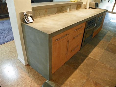 kitchen island table legs waterfall edge countertop why it belongs in your kitchen