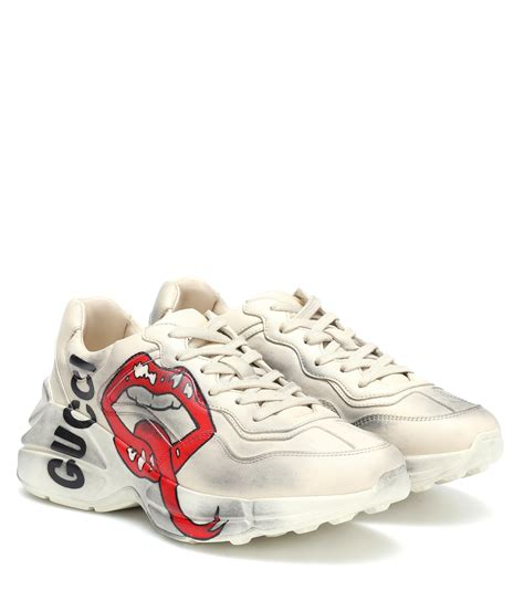 Fill shoe with tissue paper to help maintain the shape and absorb humidity, then store in the provided flannel bag and box. Gucci Rhyton Leather Sneakers - Lyst