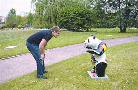 visitor checks    panda sculpture iat gardens