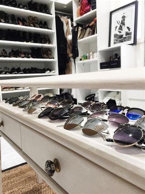 closet  glass top closet table showcasing sunglasses