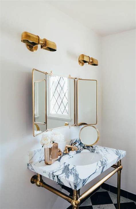 waterworks marble washstand  brass legs transitional
