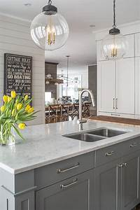 marble kitchen island countertop fitted with cutting board With best brand of paint for kitchen cabinets with wood cut out wall art