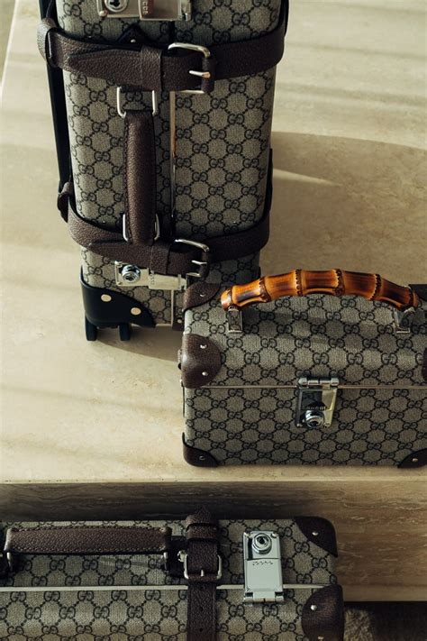 gucci collaborates  globe trotter  functional