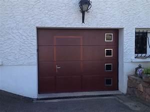 Les portes de garage sectionnelles avec portillon direct for Porte de garage coulissante jumelé avec installation porte
