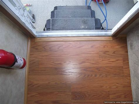 how to end laminate flooring at doorways laminate in travel trailers