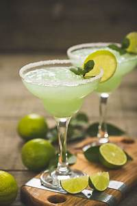 margarita cocktail with lime and mint stock photo