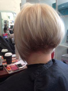 Concave Bob Hairstyles by Angled Inverted Bob With Clipper Cut Nape Inverted Bob S