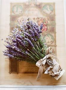 The brides lavender bouquet was dressed with vintage ...