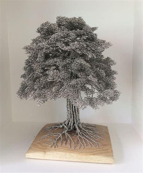 artist turns single strands  wire  elaborate tree sculptures art sheep