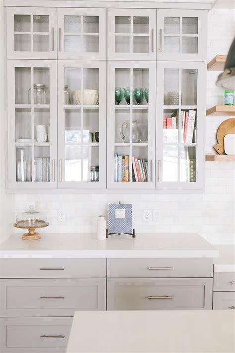 mindful grey cabinets light gray kitchen cabinets with caesarstone organic white 282   benjamin moore mindful gray glass front cabinets