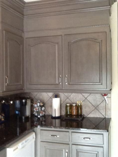 Grey glazed kitchen cabinetry   originally oak