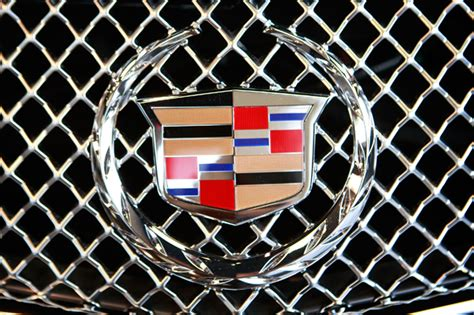 The Stories Behind 20 Famous Car Logos