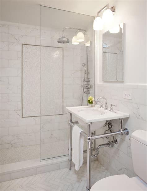 all white bathroom white marble herringbone tiles transitional bathroom 10082