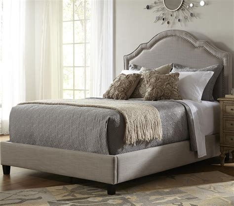 padded headboard size bed pict shaped nailhead fabric upholstered bed in taupe humble abode