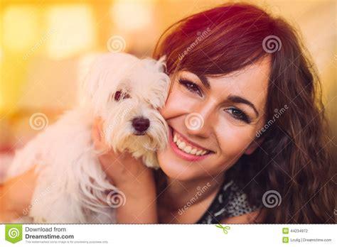 beautiful happy woman cuddling  pet dog stock photo