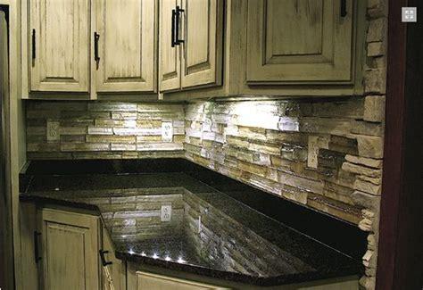 ledger backsplash tumbled stones black granite and granite on pinterest