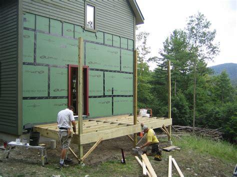 porch framing begins up hill house
