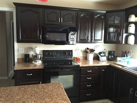 spray stain cabinets refinished with java gel stain and spray painted hardware